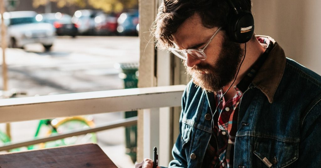 man with headphones working