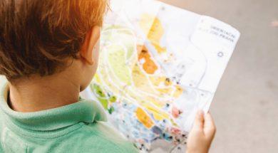 unsplash-image-child-holding-map.jpg