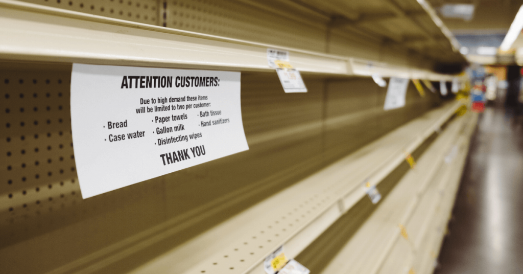 empty shelves with stock purchase limit signage