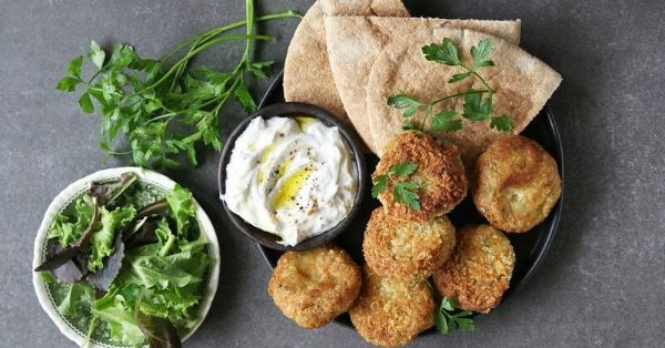 photo shows falafel balls with yoghurt dip