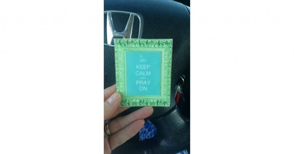 card which says keep calm and pray on