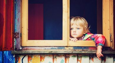 child-at-window-joel-overbeck-unsplash.jpg