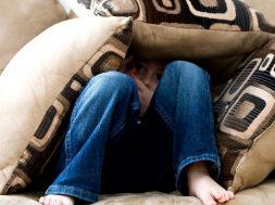 boy-hiding-under-cushions-pexels-pixabay.jpg