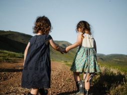 girls-holding-hands-josue-michel-unsplash.jpg