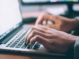 typing-on-laptop-glenn-carstens-peters-unsplash.jpg