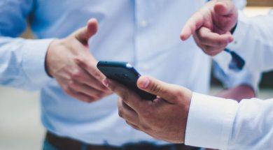 men-looking-at-phone-luis-villasmil-unsplash.jpg