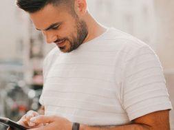 man-typing-phone-malte-helmhold-unsplash.jpg